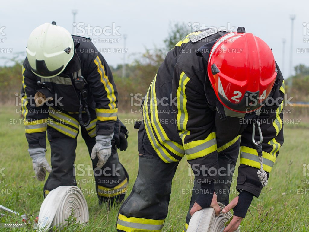 fire practice with hose stock photo