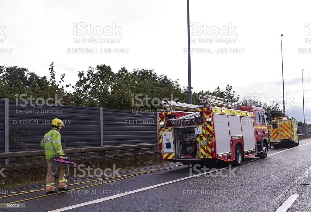 Fire rescue attending motorway crash stock photo