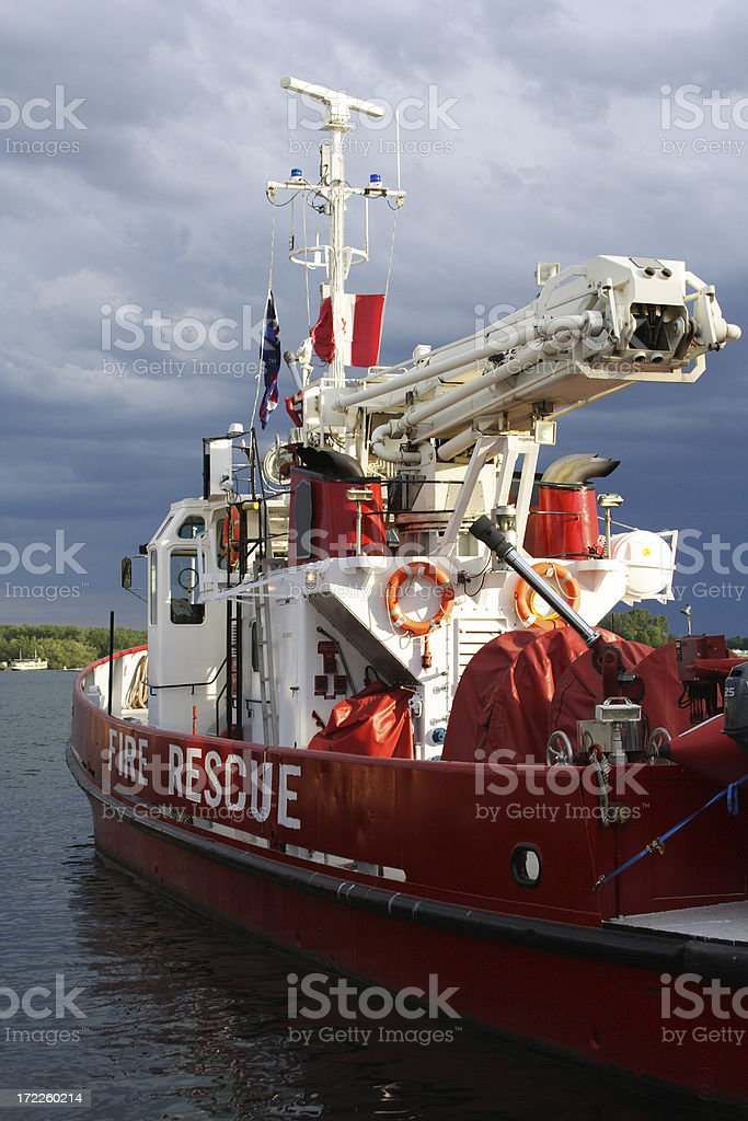 Fire Rescue Boat Against An Ominous Sky royalty-free stock photo