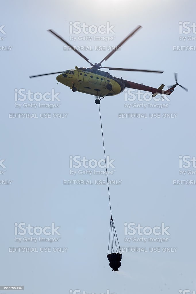Fire rescue helicopter with water bucket stock photo