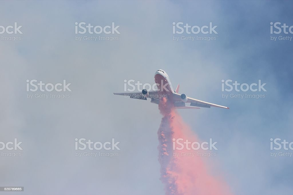 VLAT DC 10 fire retardant drop stock photo