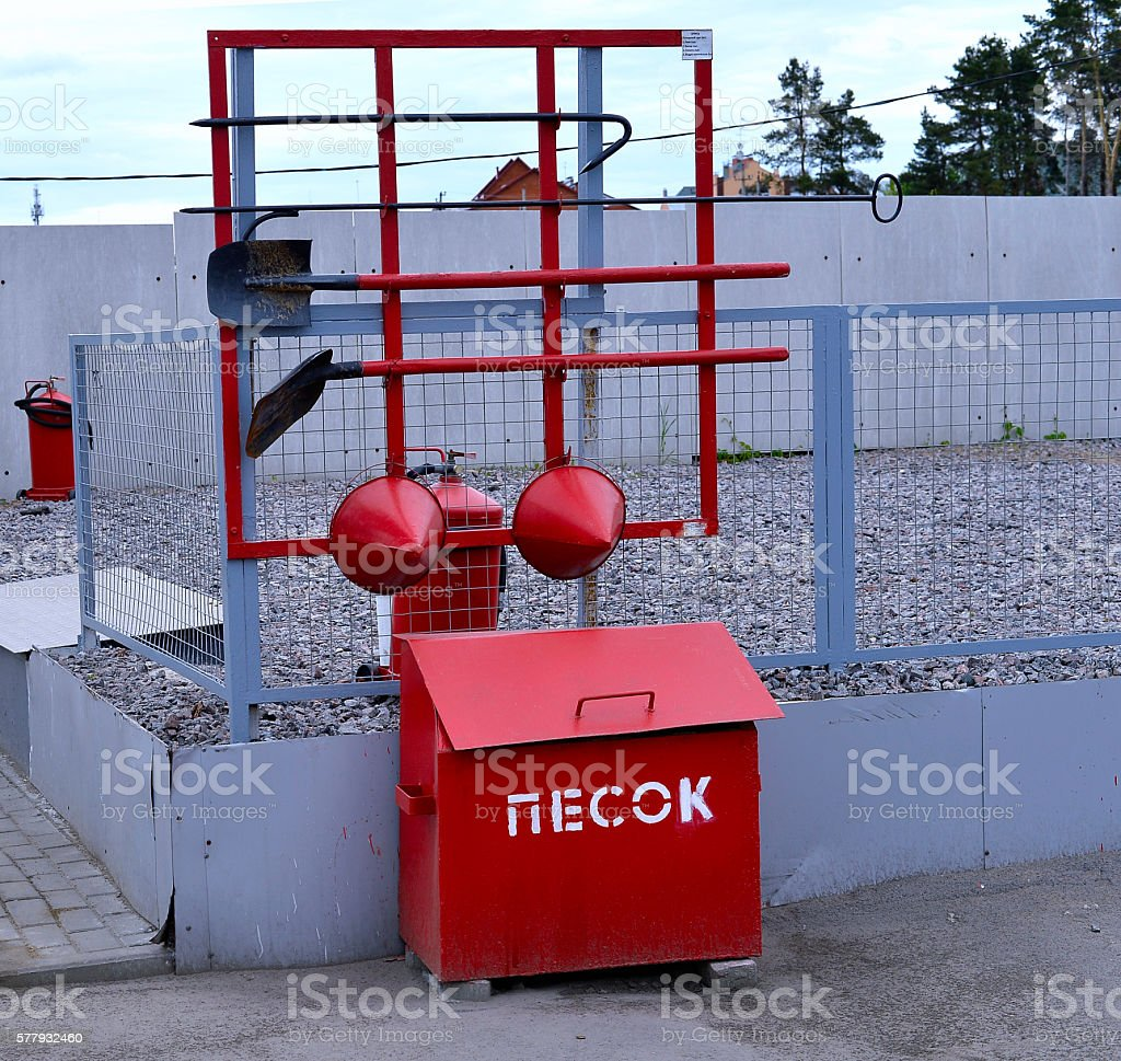 Fire Shield on the wall. Set primary fire extinguishing equipme stock photo