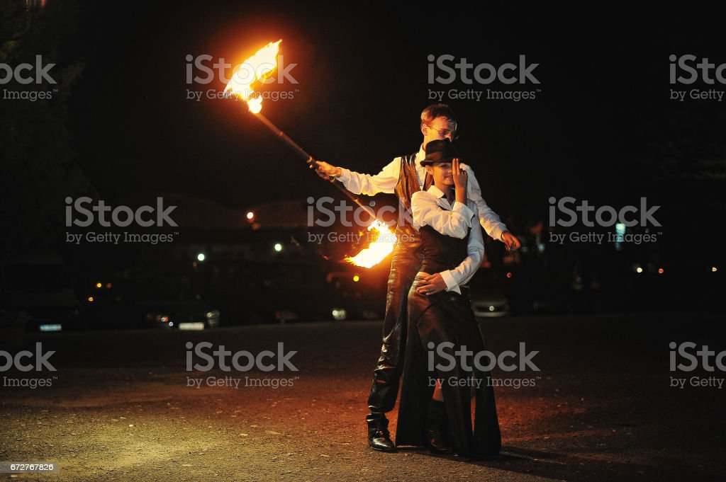 Fire show at the night on wedding ceremony stock photo