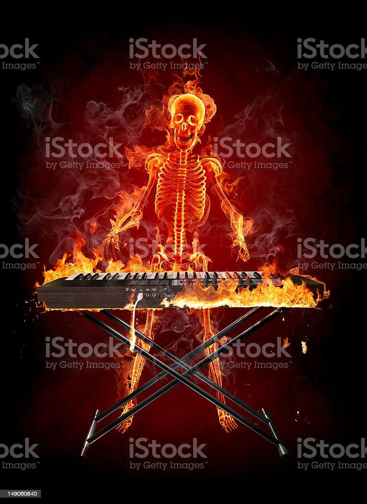 Fire skeleton - keyboardist royalty-free stock photo