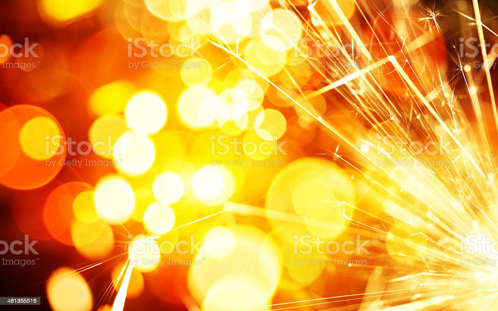 Fire Sparkler with defocused lights background stock photo