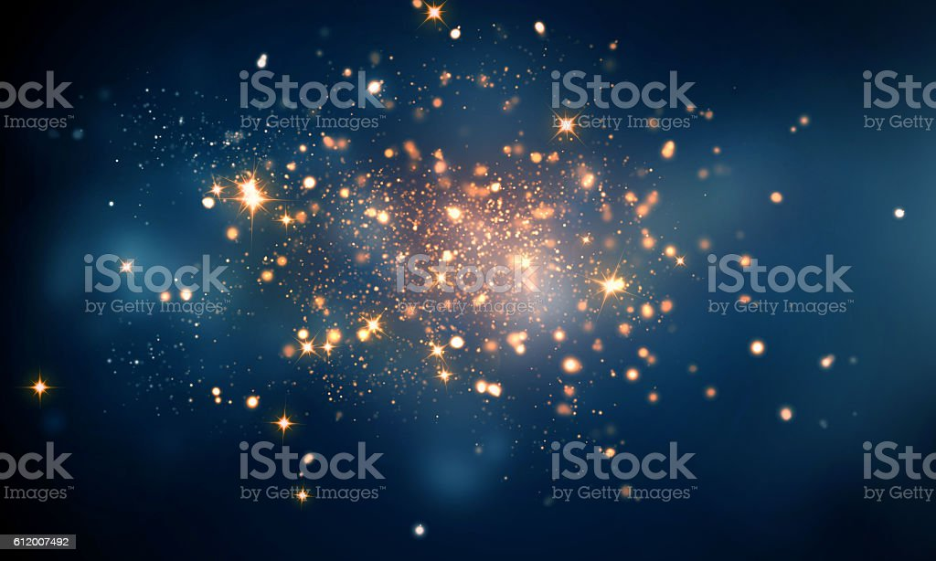 fire sparkles in dark blue bokeh background stock photo