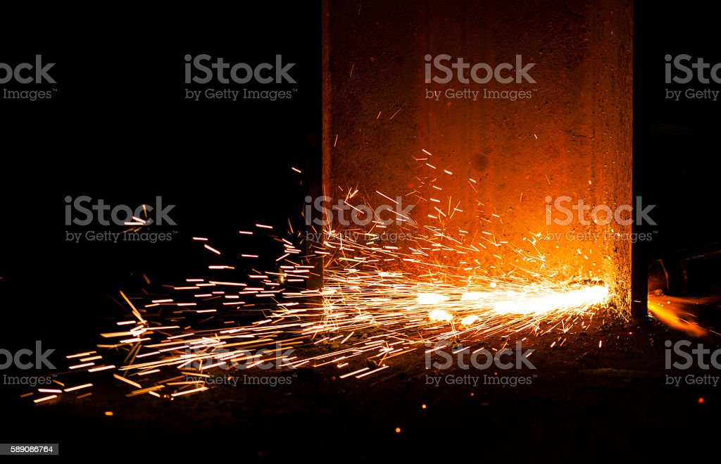 fire sparks - industry manufacturing stock photo