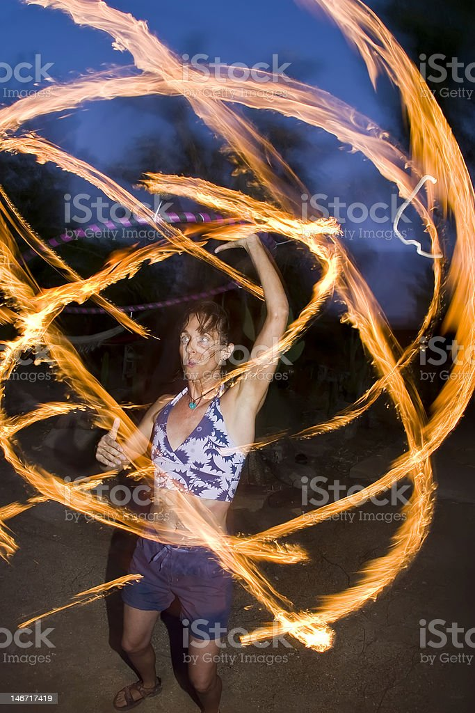 Fire spinning, hoop dancer, performing. stock photo