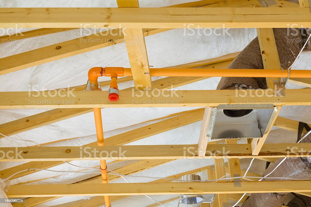 Fire sprinkler system on the exposed beams of a building stock photo