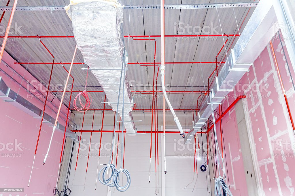 Fire sprinkler system with red pipes is placed to hanging. stock photo