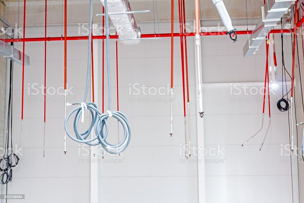 Fire sprinklers are part of an integrated water piping system. stock photo