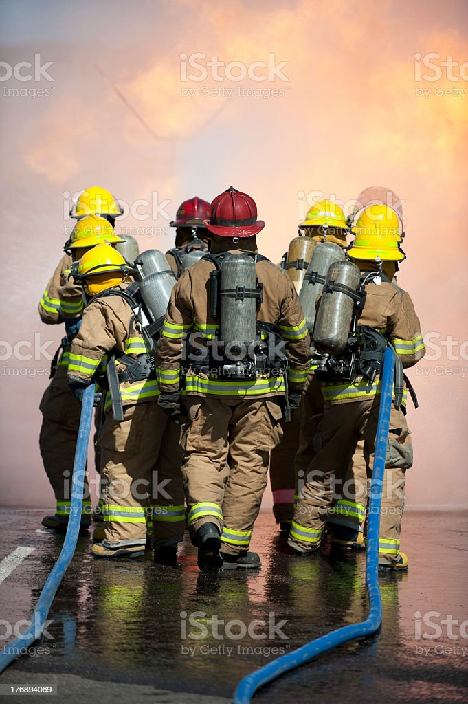 Fire training exercise with blue hoses stock photo