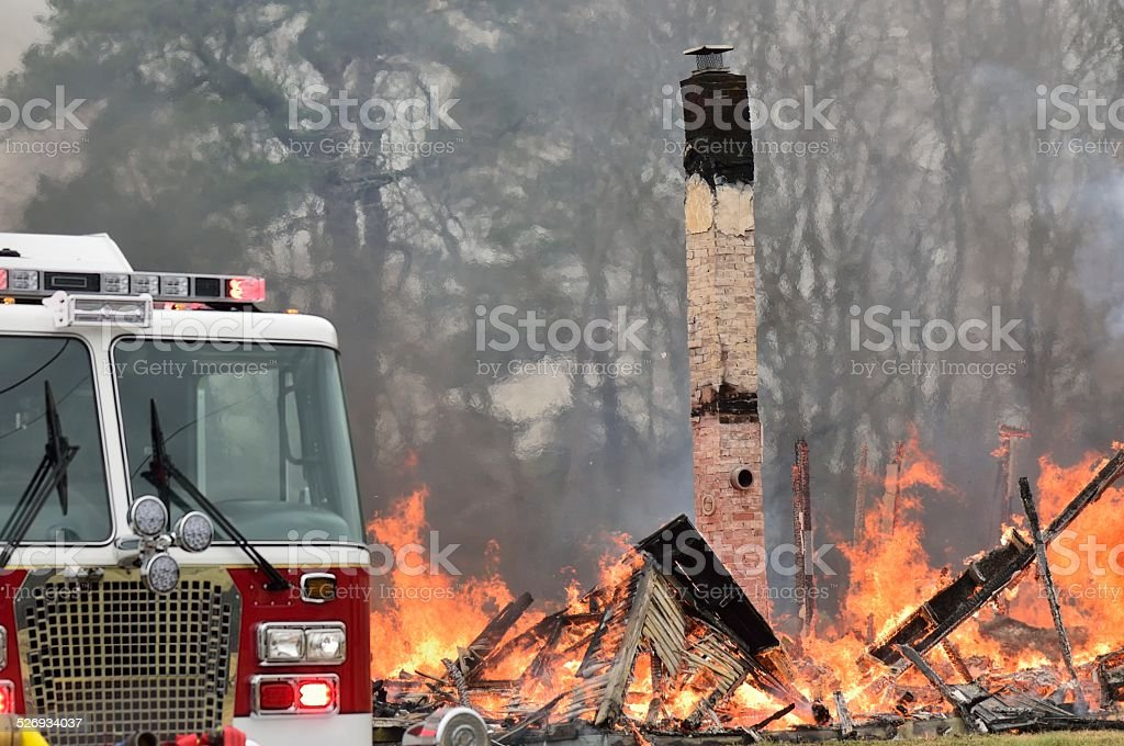 Fire Truck And Burning Building stock photo