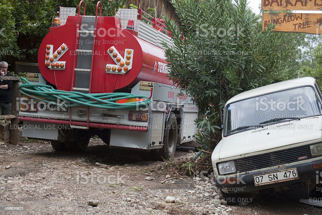 Fire truck and car on dirt road royalty-free stock photo