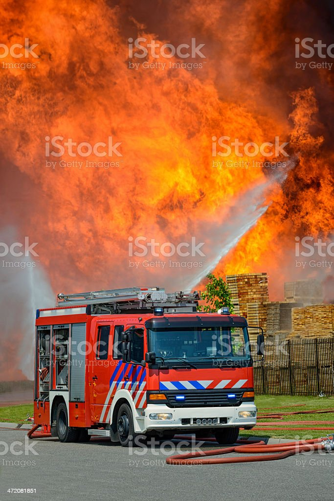 Fire Truck in front of huge flames royalty-free stock photo