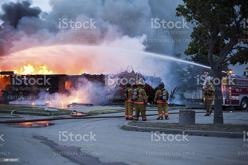 Fire Truck Spraying Blaze stock photo