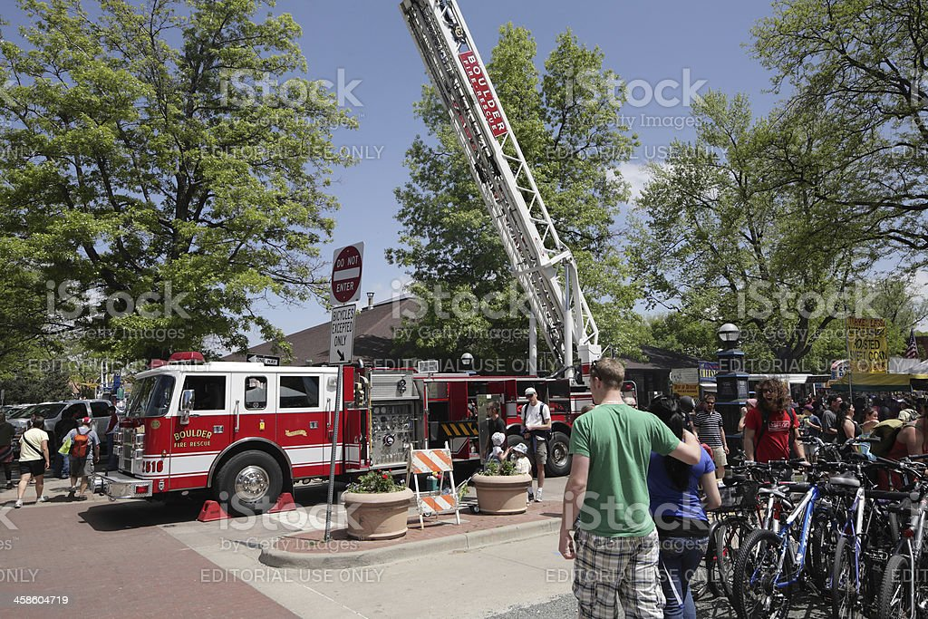 fire truck with extended ladder at a street fair stock photo