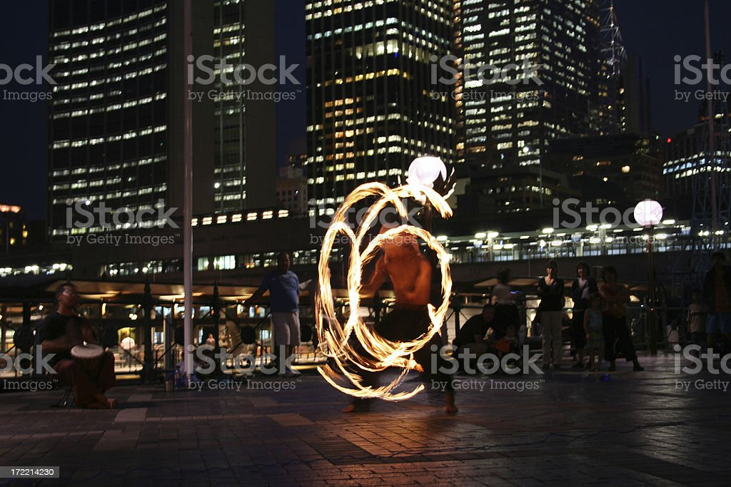 fire twirler in Sydney royalty-free stock photo