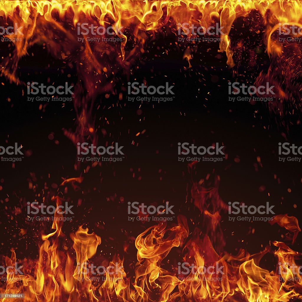 XXXL Fire with bright sparks isolated on black background stock photo