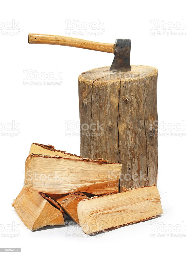 Fire wood and old axe stock photo