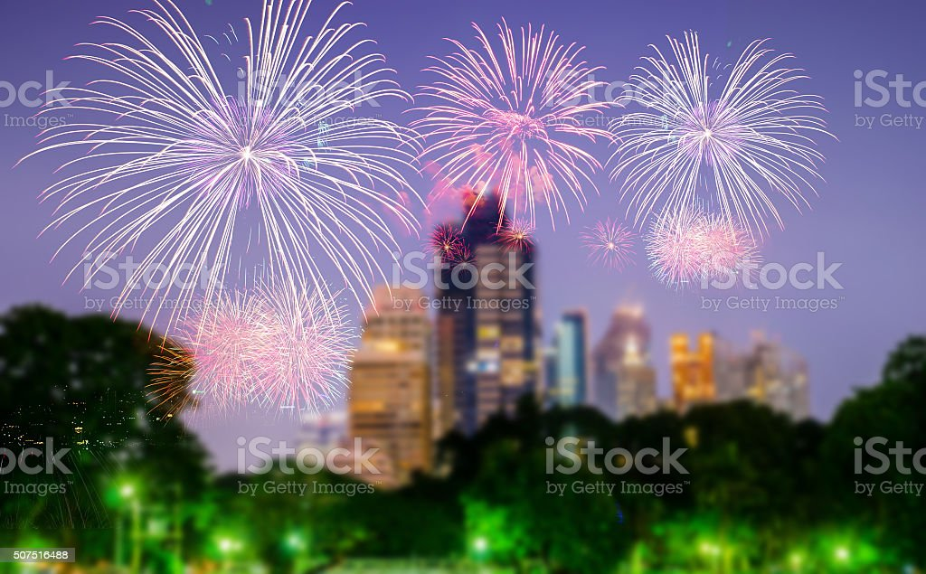 fire work on blur city scape background stock photo