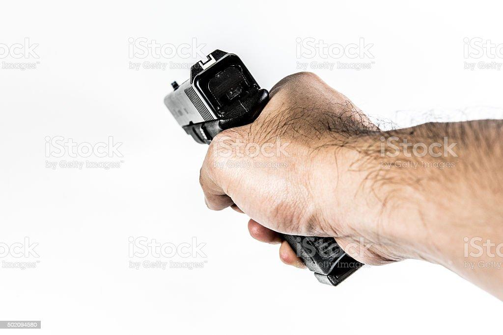 firearm gun in hand stock photo