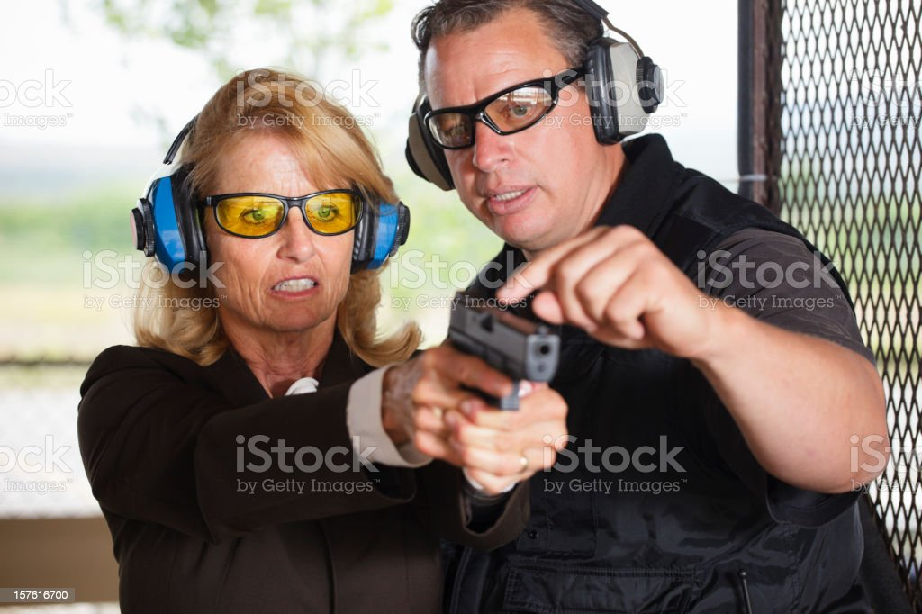 Firearm Instructor and Student stock photo