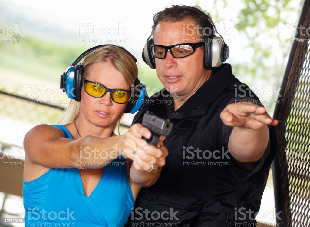 Firearm Instructor and Student royalty-free stock photo
