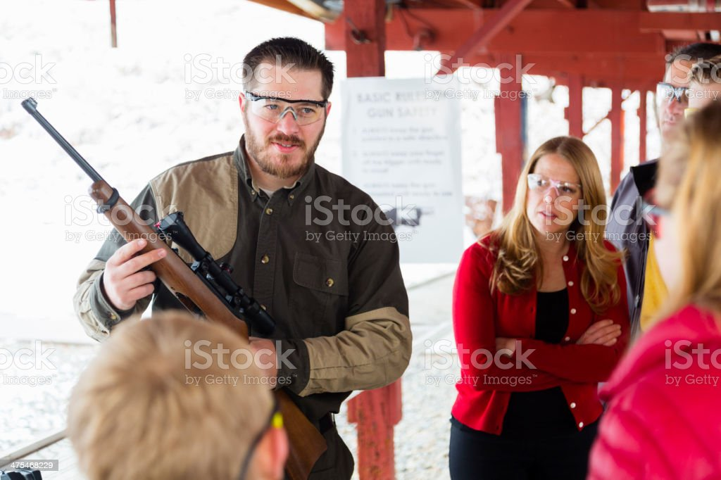Firearms Instructor at the Shooting Range royalty-free stock photo