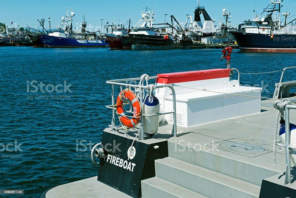 Fireboat and fishing fleet in Seattle WA stock photo