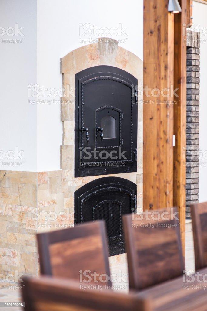 Firebox door of a retro wood burning stove stock photo