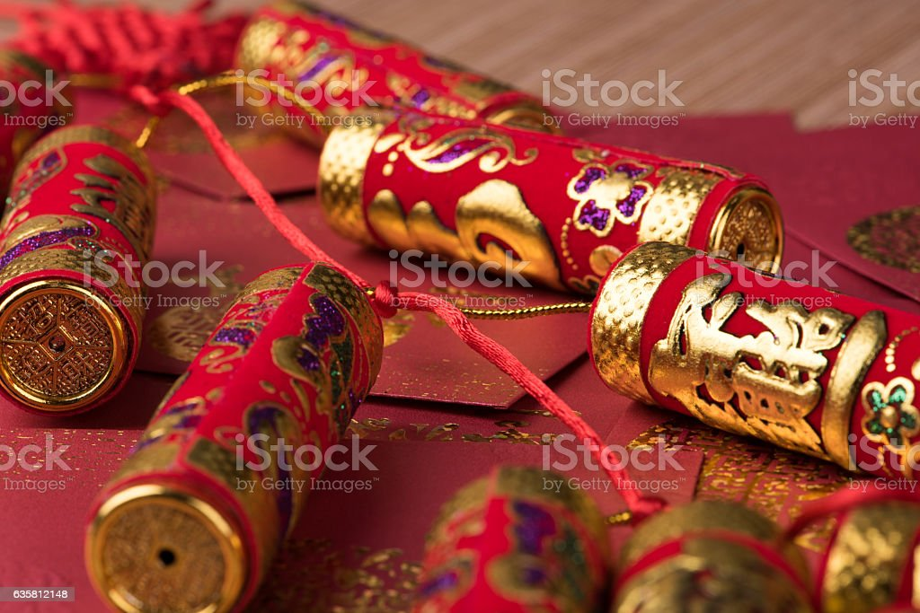 Firecreckers on red envelopes stock photo