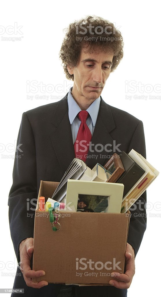Fired businessman in suit and tie stock photo