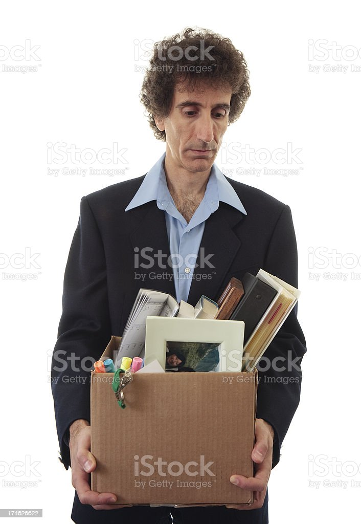 Fired businessman in suit stock photo