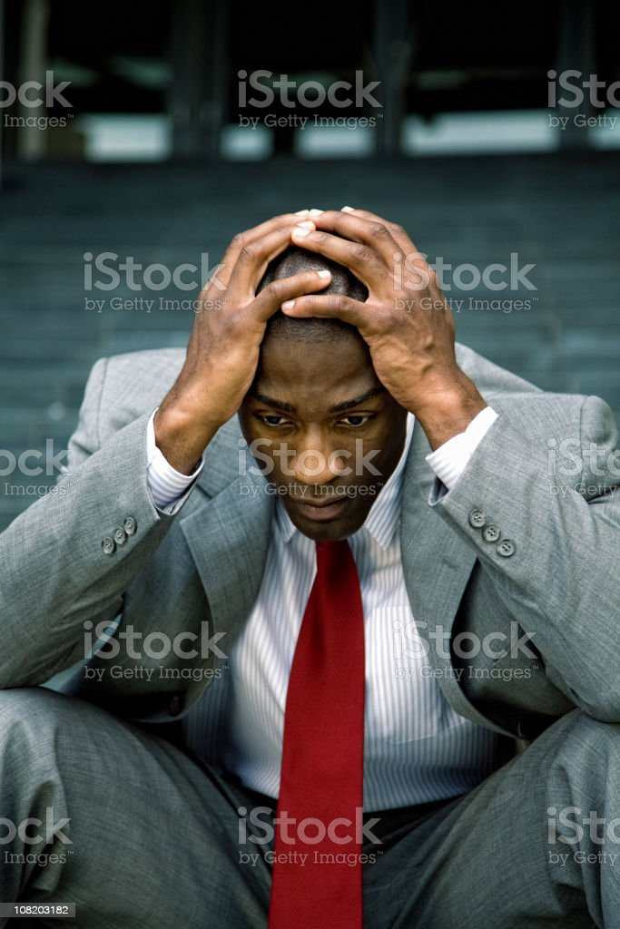 Fired businessman in total despair royalty-free stock photo