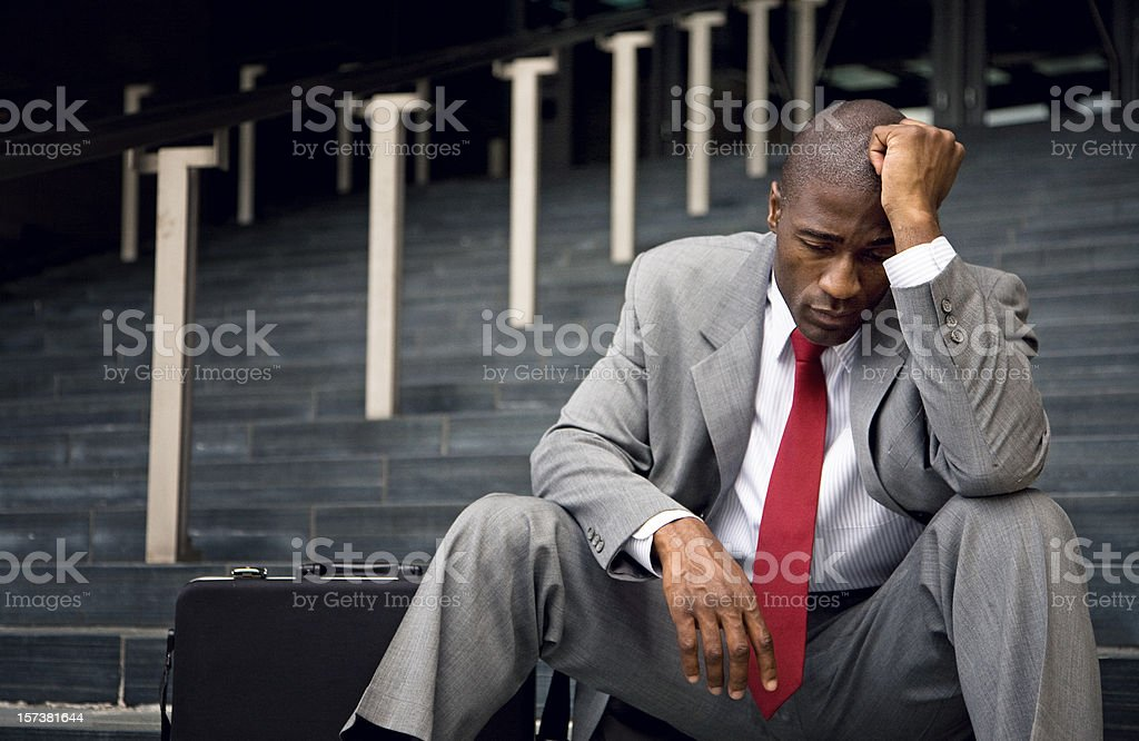 Fired businessman in total despair stock photo