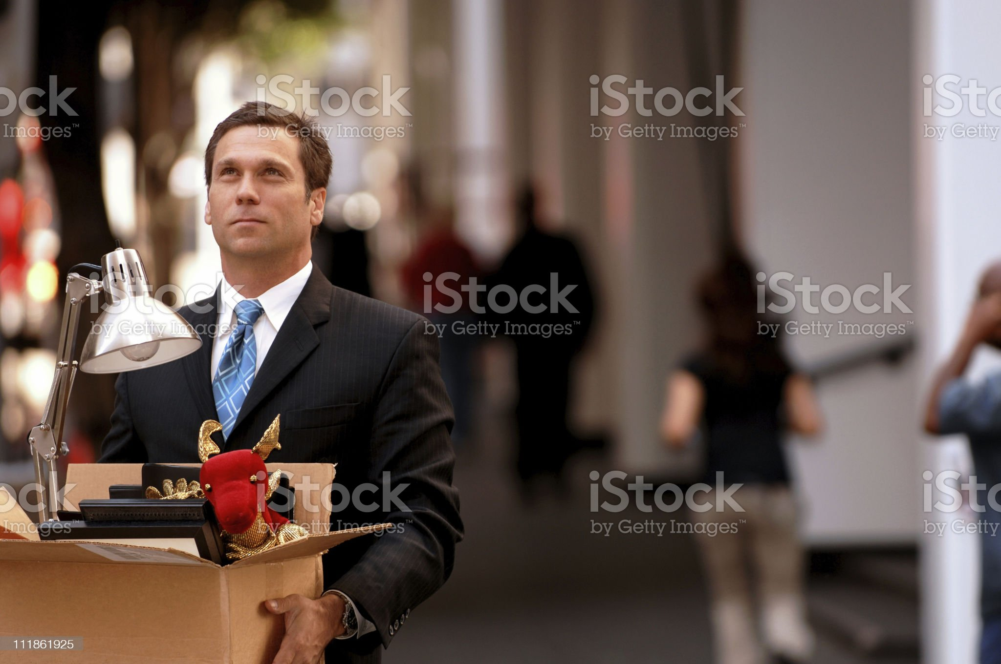 Fired Businessman with Cardboard Box of Belongings royalty-free stock photo