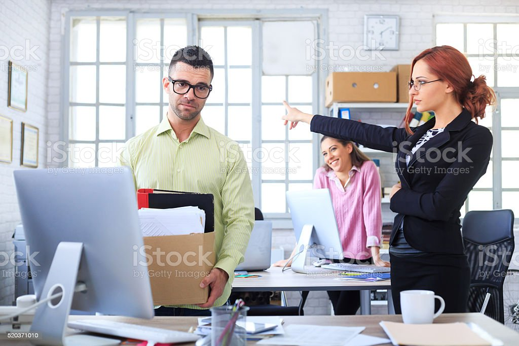 Fired man leaving the office stock photo