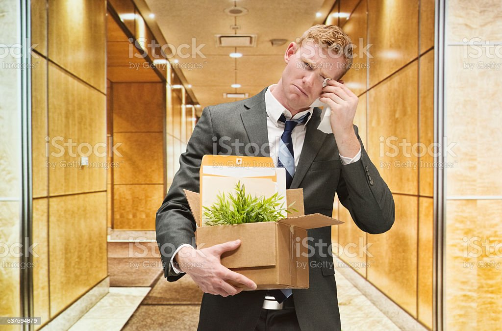 Fired office worker crying stock photo