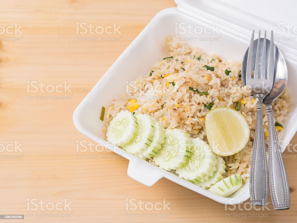 Fired rice with sliced cucumber and lemon, royalty-free stock photo