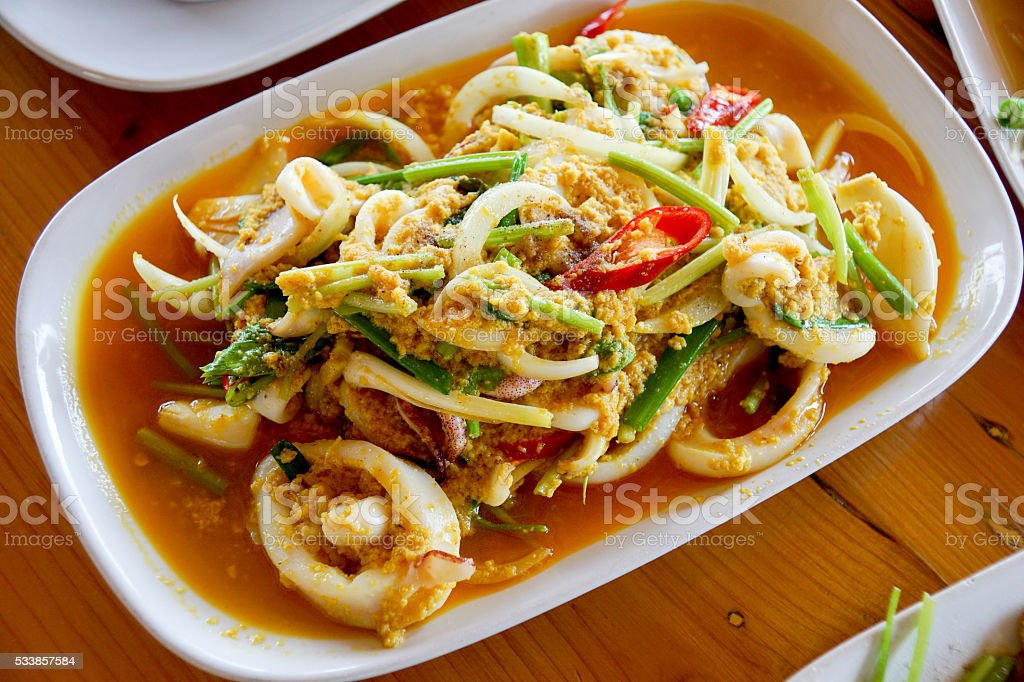 Fired squid with salty egg (Thai food) stock photo