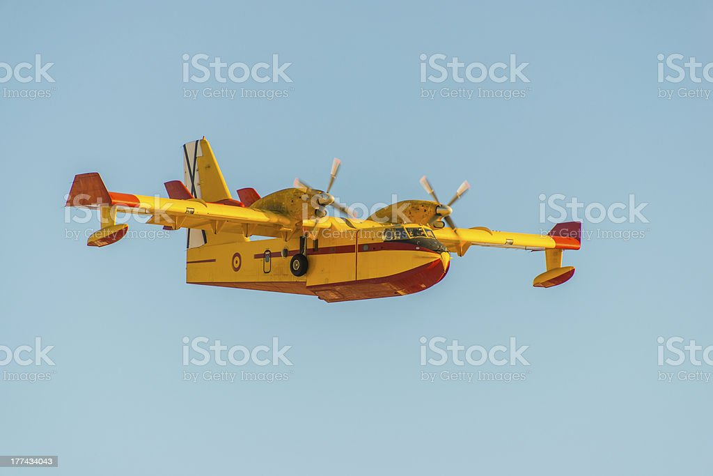 Firefighter airplane on sky background royalty-free stock photo