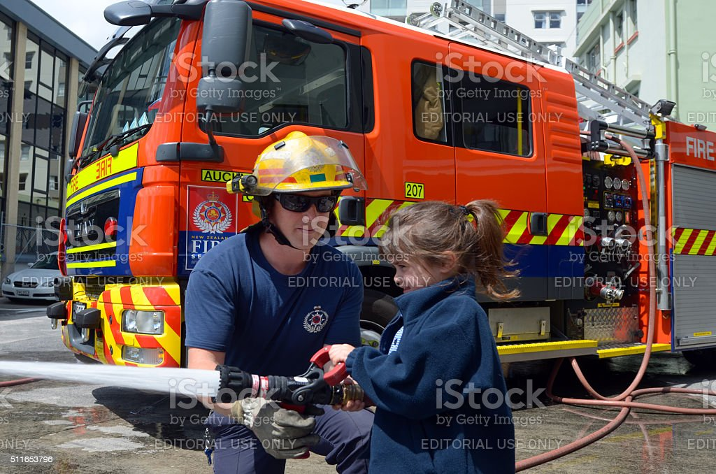 Firefighter and child stock photo