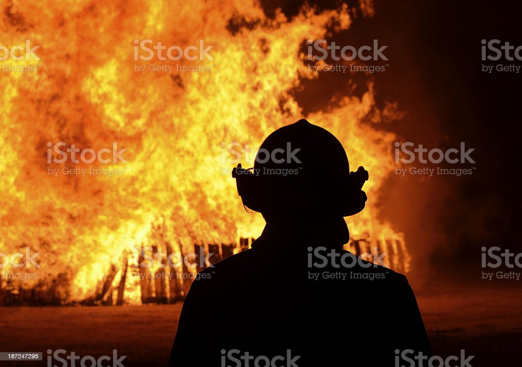 firefighter and flame royalty-free stock photo