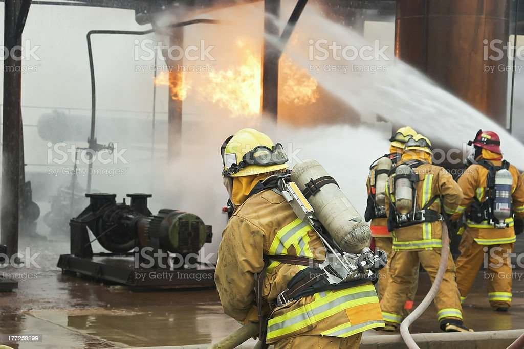 Firefighter Assist stock photo