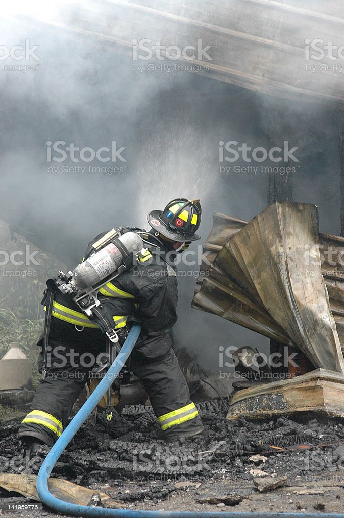 Firefighter At Work royalty-free stock photo