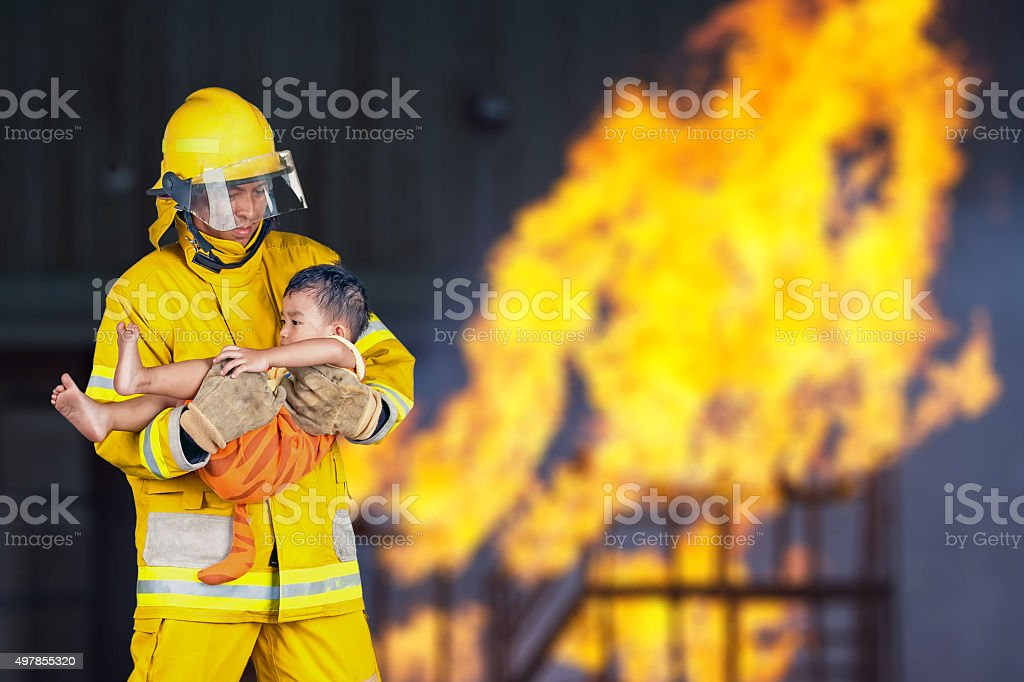 firefighter, fireman rescued the child from the fire stock photo