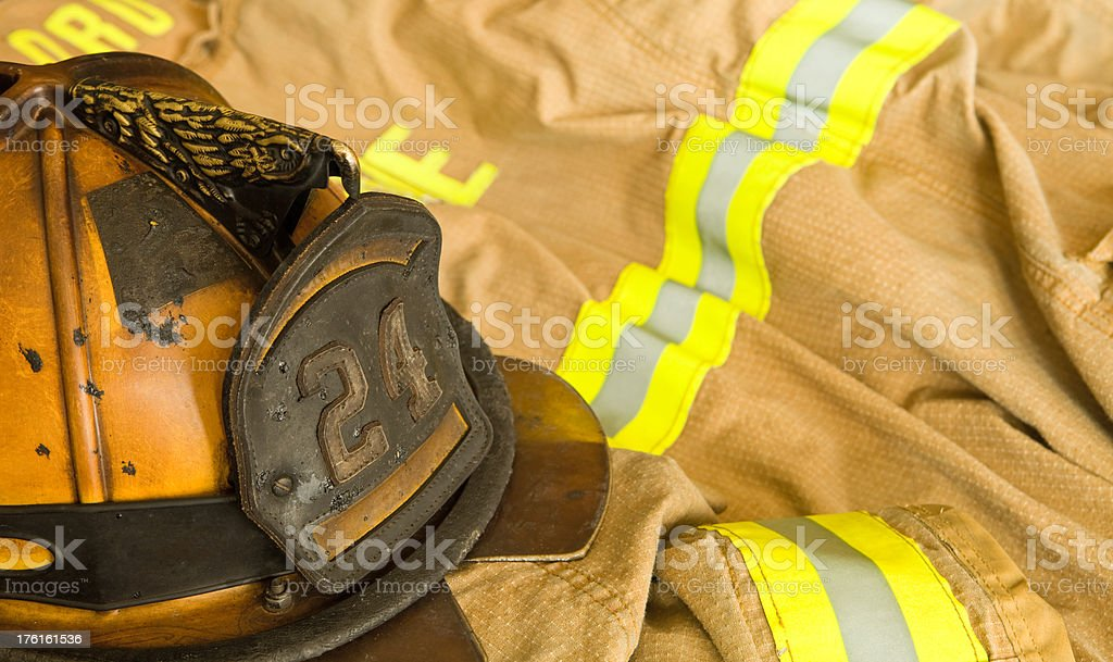 Firefighter Helmet and Jacket Ready for Work stock photo