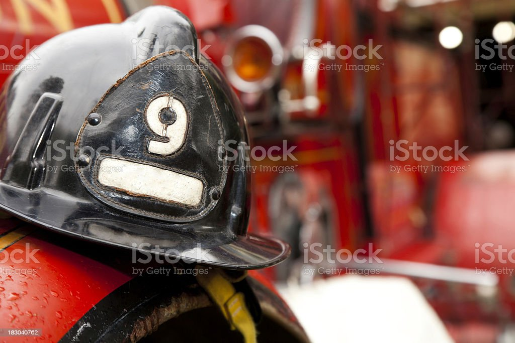 Firefighter Helmet Resting on Firetruck stock photo