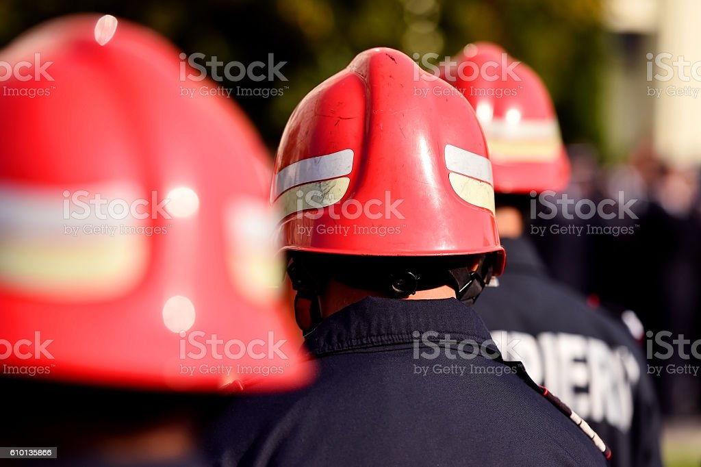 Firefighter helmets seen from behind during parade stock photo